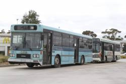 Ex-Transdev buses #323 and #5160 stored at the Calder Freeway truck stop at Calder Park