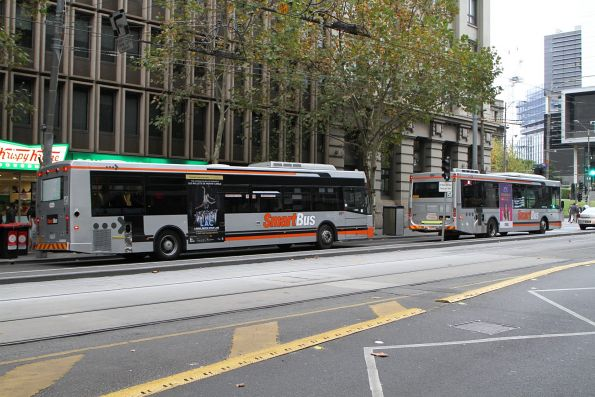 Pair of Smartbus liveried Transdev buses head west on services to Fishermans Bend at Collins and Spencer Street