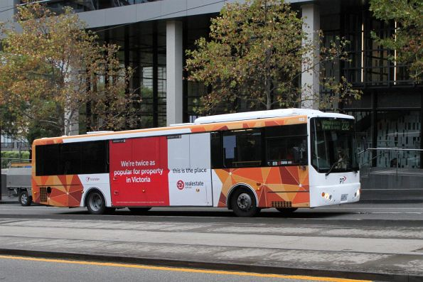 Transdev bus #583 heads west on route 232 at Collins and Spencer Street