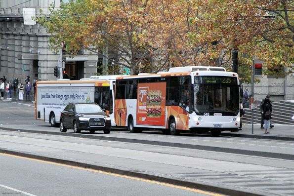 Transdev bus #545 heads west on route 235 at Collins and Spencer Street