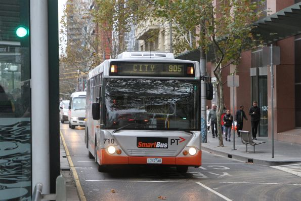 Transdev bus #710 1769AO heads empty south on Spencer Street after running a route 905 service