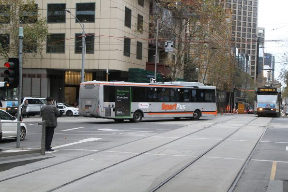 Transdev bus #558 does a hook turn at Collins and William Street