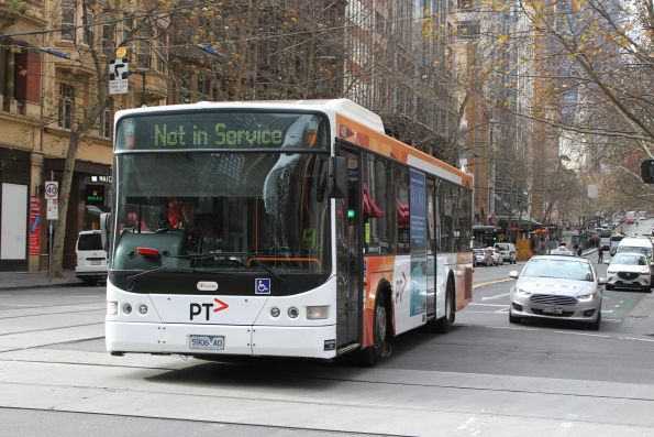 Transdev bus #406 5906AO heads west out of service at Collins and Elizabeth Street