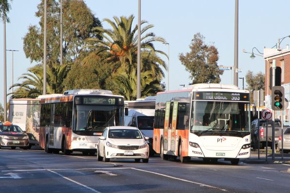 Transdev bus BS03WK on route 903 passes CDC Melbourne bus #74 6139AO on route 410 at Sunshine station