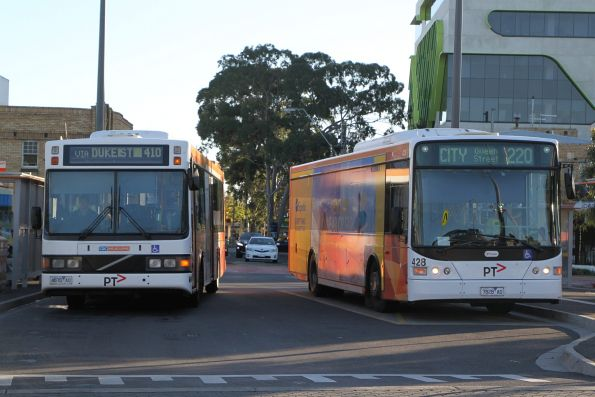 CDC Melbourne bus 4870AO on route 410 passes Transdev bus #428 7828AO on route 220 at Sunshine station