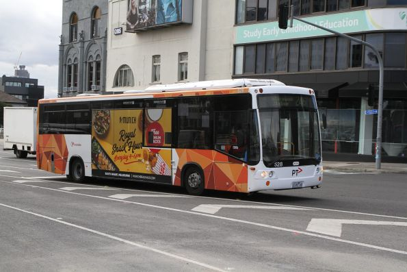 Transdev bus #528 2149AO on route 246 at St Kilda Junction
