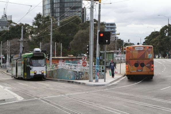 Transdev bus #541 5837AO on route 246 passes tram Z3.167 on route 16 at St Kilda Junction