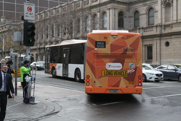 Transdev articulated bus #181 BS03WW turns from William into Lonsdale Street
