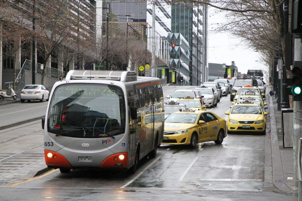 Transdev bus #653 7276AO heads east on route 235 at Collins and Spencer Street