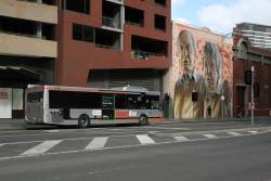 Transdev bus #8257 6679AO on route 906 terminates at Lonsdale and Spencer Street
