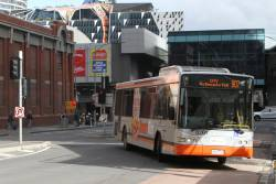 Transdev bus #8261 6547AO on route 907 turns around at Lonsdale and Spencer Street