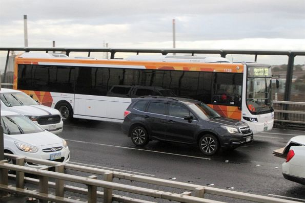 Transdev bus #1128 heads west on route 232 over the West Gate Bridge
