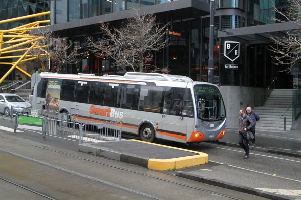 Transdev bus #654 heads west on route 235 along Collins Street in Docklands