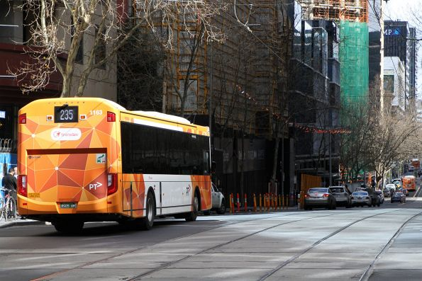 Transdev bus #1163 BS05AM heads west on route 235 at Collins and William Street