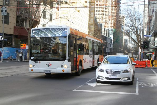 Transdev bus #740 1740AO heads east on route 235 at Collins and William Street