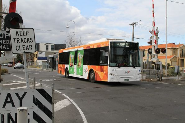 Transdev bus #105 BS00SW on route 903 crosses the railway at Altona station