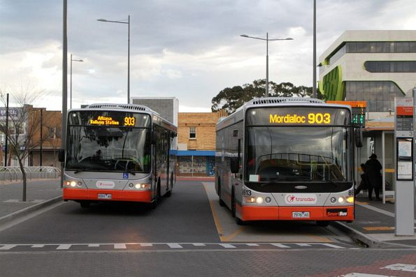 Transdev buses 8069AO and 7976AO pass on route 903 at Sunshine station