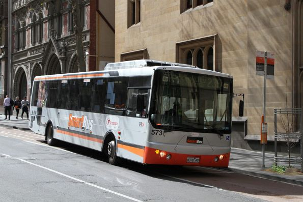 Transdev bus #573 6338AO heads south on route 236 at Queen and Collins Street