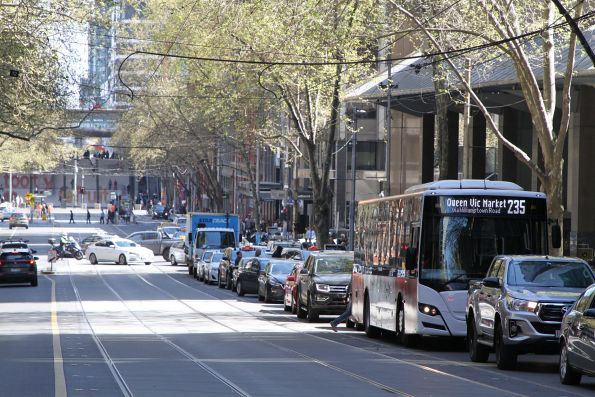 Transdev bus #1116 BS05CN on route 235 stuck in traffic at Bourke and William Street