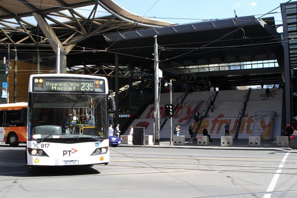 Transdev bus #917 6519AO on route 235 turns from Spencer into Bourke Street