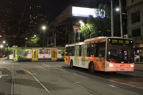 Transdev bus #423 7523AO on route 219 passed by a route 30 tram at Spencer and La Trobe Street