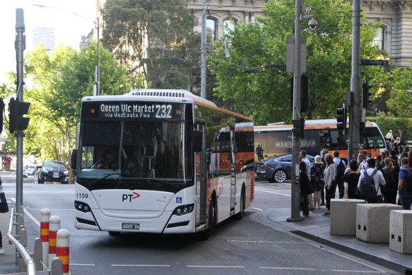 Transdev bus #1159 BS05DR turns from Collins into Spencer Street on route 232