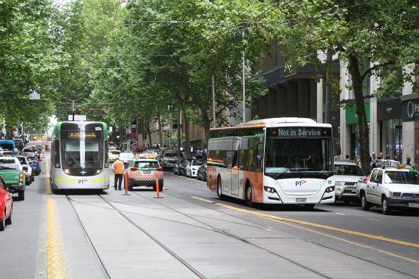 Transdev bus #1126 BS05CU heads east out of service at Collins and Queen Street