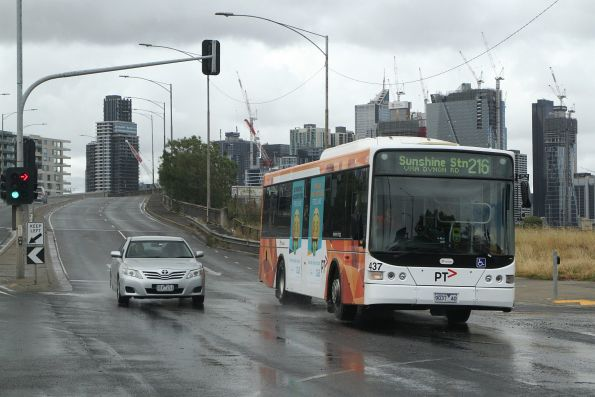 Transdev bus #437 9037AO on route 216 heads west along Dynon Road