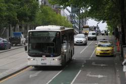 Transdev bus 7523AO heads east on route 232 at Collins and Spencer Street