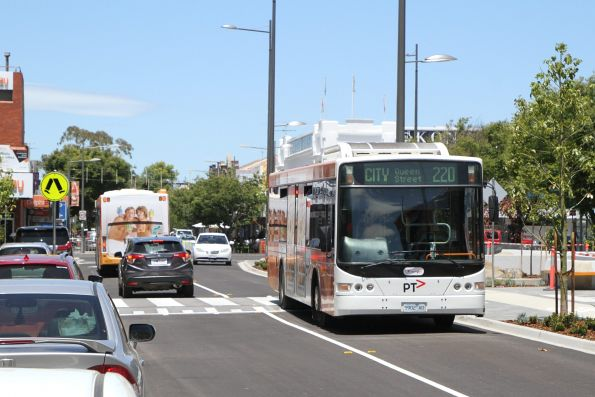 Transdev bus #402 5902AO on route 220 heads along a redeveloped Hampshire Road in Sunshine