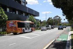 Transdev bus #401 5901AO on route 220 heads along a redeveloped Hampshire Road in Sunshine