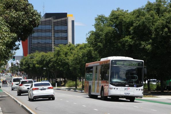Transdev bus #424 7824AO on route 220 heads along a redeveloped Hampshire Road in Sunshine