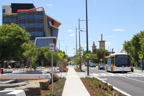 Transdev bus #438 9038AO on route 220 heads along a redeveloped Hampshire Road in Sunshine