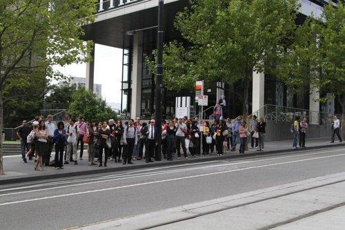 Hoards of passengers waiting outside Southern Cross for the bus to Fishermans Bend