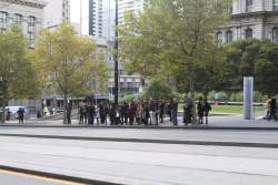 Passengers waiting at Collins and Spencer Street for a bus towards Fishermans Bend