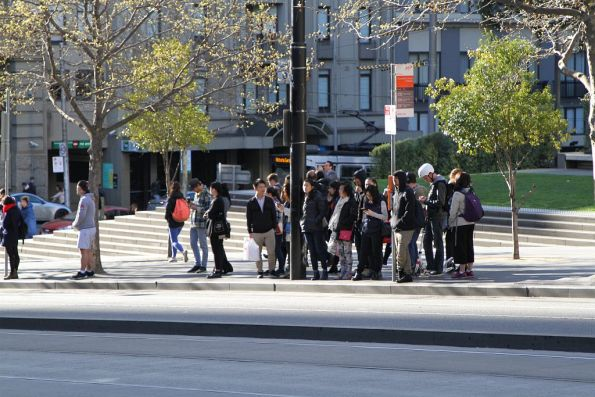 Crowd of passengers opposite Southern Cross Station waiting for the next bus to Fisherman's Bend