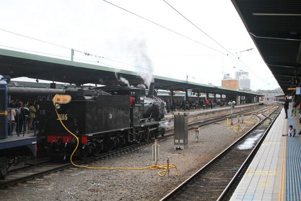 Watering steam locomotive 3016 at Central