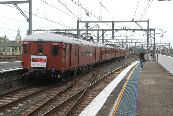 Single deck suburban electric set F1 passes through Redfern on the down