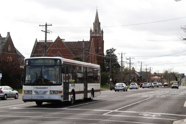Tullamarine Bus Lines #22 rego 1122AO on a route 477 service arrives at Essendon station