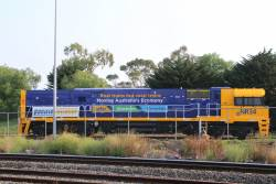 'Real trains not road trains' decals on the side of NR34 at UGL Spotswood