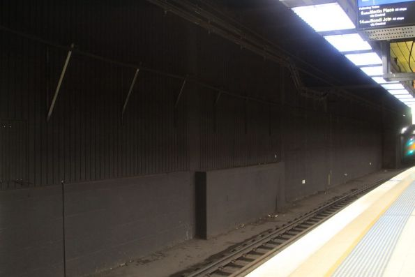 Sheetmetal wall divides Redfern's underground platform 11 from the giant hole next door