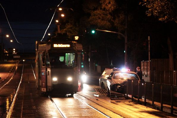 Z3.163 passes yet another smashed car at the tram stop outside Flemington Racecourse