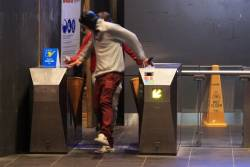 Pair of fare evaders jumping through the barriers at Southern Cross