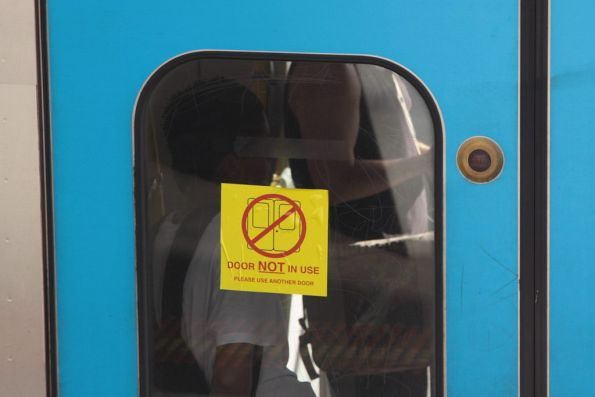'Door not in use' sticker on a Siemens train, along with the tiny 'Door out of order' lamp illuminated