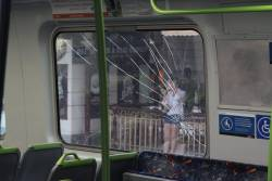 Smashed saloon window onboard a Comeng train