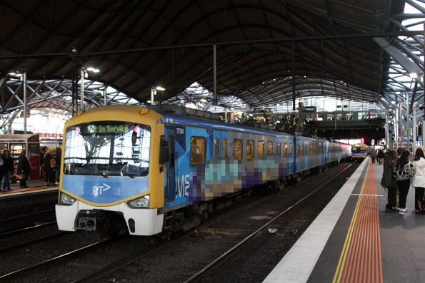 Siemens 770M headed empty cars to Flinders Street via Southern Cross track 10A, with a massive graffiti mural on the side