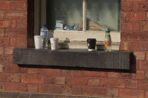 Rubbish ledge at North Melbourne station, thanks to the removal of rubbish bins