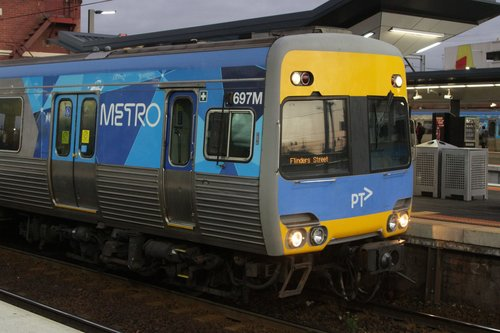 Alstom Comeng 697M in service with a set of defective front saloon doors