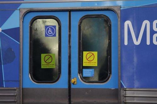 Suburban train in service with a set of defective front saloon doors