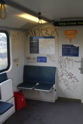 Filthy graffiti covered walls at the end of a Siemens train